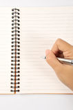 Notebook in hand. Pen in hand Royalty Free Stock Photos