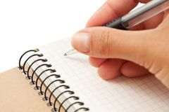 Notebook and hand with pen Royalty Free Stock Photos