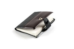 Notebook and handle for business. Are isolated on a white background Stock Photos