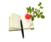 Notebook, the handle and rose Royalty Free Stock Photography
