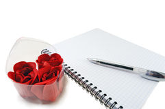 Notebook with the handle and roses in a box Stock Photos