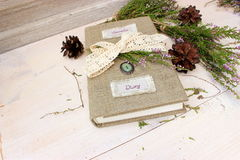 Notebook with handmade textile cover decorated with crochet ribbon and natural evergreen plants. Craft theme Stock Photography