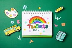 Notebook Happy teachers day decorative school supplies on green background