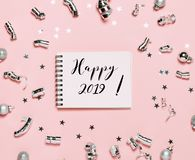 Notebook with Happy 2019 text on pink background. stock photo