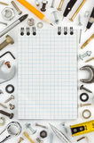 Notebook and hardware tools Royalty Free Stock Images
