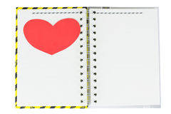 Notebook and heart. Notebook yellow, black, gray cover and heart Stock Photography