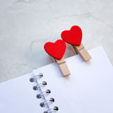 Notebook and hearts Royalty Free Stock Images