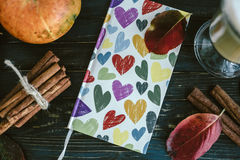 Notebook with hearts, pumpkin, cinnamon and leaves. Autumn conce Stock Image