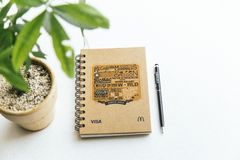 Notebook and houseplant stock image