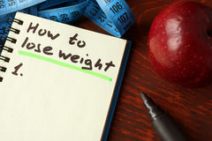 Notebook with how to lose weight sign. Diet concept Stock Image