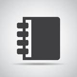 Notebook icon with shadow on a gray background. Vector illustration Royalty Free Stock Photos