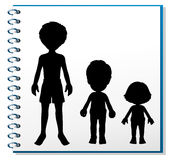 A notebook with an image of three humans Stock Photo