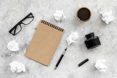 Notebook, ink, dip pen, coffee, glasses for writer workplace set on stone office background top view mock-up. Notebook, ink, dip pen, coffee, glasses for writer royalty free stock image