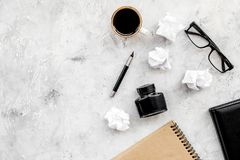 Notebook, ink, dip pen, coffee, glasses for writer workplace set on stone office background top view mock-up. Notebook, ink, dip pen, coffee, glasses for writer royalty free stock photos