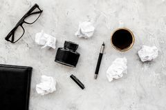 Notebook, ink, dip pen, coffee, glasses for writer workplace set on stone office background top view mock-up. Notebook, ink, dip pen, coffee, glasses for writer royalty free stock photo