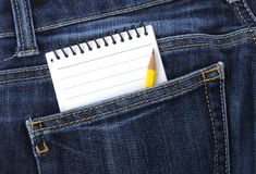 Notebook in jeans pocket Royalty Free Stock Photos
