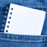 Notebook in jeans poket Royalty Free Stock Image