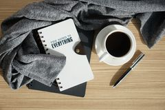Notebook journal with coffee and warm cloth. On wood table. Morning breakfast. Top view flat lay Stock Photos