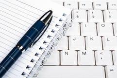 Notebook on keyboard Stock Photos
