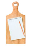 Notebook on the kitchen board Royalty Free Stock Photography