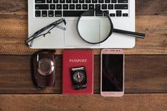 Notebook laptop, camera, passport, compass, smartphone on a wooden table Royalty Free Stock Photo