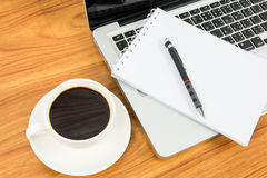 Notebook laptop and coffee cup Stock Image