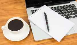 Notebook laptop and coffee cup Royalty Free Stock Photography