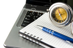 Notebook laptop, compass and pen on white Royalty Free Stock Photos