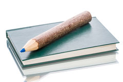 Notebook and a large pencil Royalty Free Stock Image