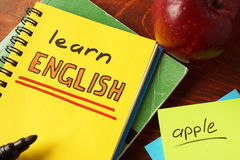 Notebook with learn English  sign. Royalty Free Stock Photos