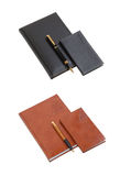 Notebook in leather cover and ball point pen. On a white background royalty free stock photography