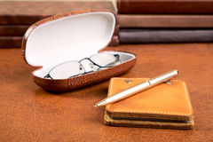 Notebook with  leather cover  pen and glasses Stock Photography