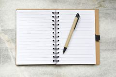 Notebook  lie on a marble background Stock Image