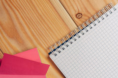 Notebook lies on the table, stickers for notes, desktop stock photo