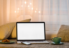 Notebook in living room. Home working concept Stock Photos