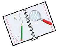 notebook and magnifier Royalty Free Stock Photo