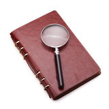 Notebook with a magnifier Royalty Free Stock Photo