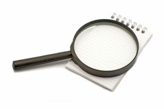 Notebook and magnifier Stock Photo