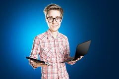 Notebook. Man with Notebook and tablet Royalty Free Stock Image