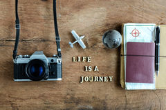 Notebook with map, passport and camera on wooden background Stock Photography