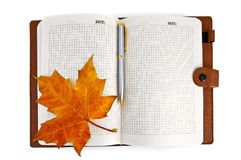 Notebook with a maple leaf Stock Photography