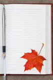 Notebook and maple leaf Royalty Free Stock Photo