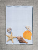 Notebook and Maritime Souvenirs. Summer travel vacation Stock Photography