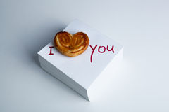 Notebook with marker inscription I love you and biscuit Stock Image