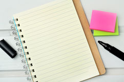 Notebook with marker and note Stock Photo