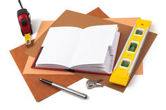 Notebook and measuring instruments on textured paper Royalty Free Stock Images
