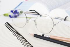 Notebook memo ,dictionary book and spectacle of student for study. Arrangement flat lay style on background white royalty free stock images
