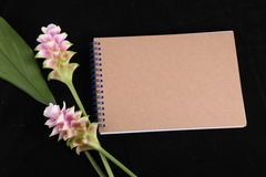Notebook memory with a flower. Royalty Free Stock Photography