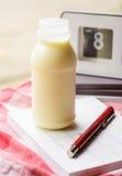 Notebook and milk Stock Photos