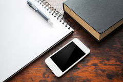 Notebook and mobile phone Royalty Free Stock Photography